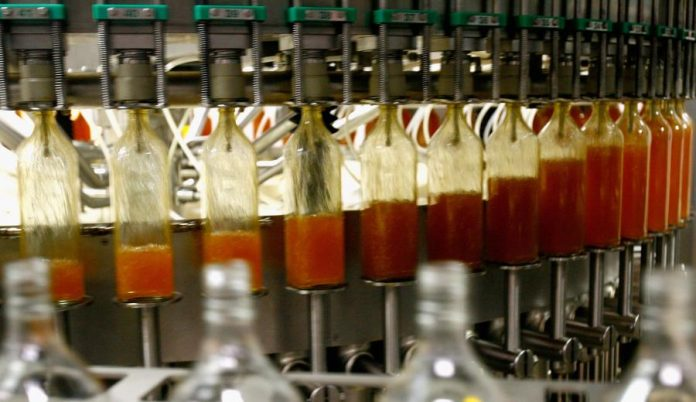 Whisky is machine fed into bottles at Sheildhall bottling plant in Glasgow March 18, 2008 in Scotland..