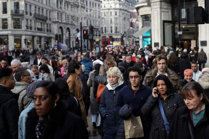 Shoppers walk along Regents Street in London, Britain December 22, 2017.