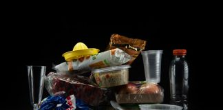 This illustration shows plastic containers, cutlery and plastic wrapped food packaging taken on August 12, 2018, in a studio in Paris.