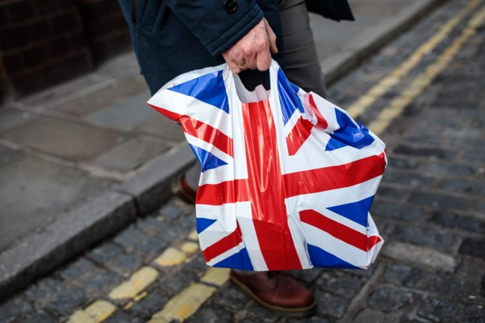A plastic Union Flag bag is carried by a shopper on December 27, 2018 in London, England.