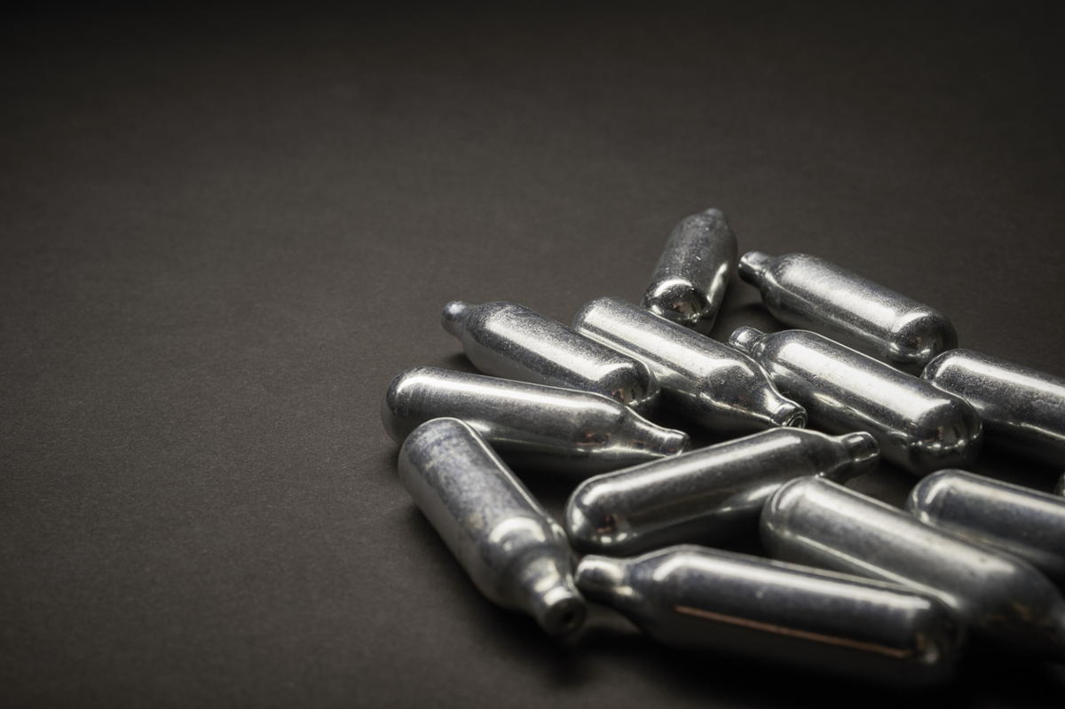 Nearly 400 laughing gas canisters seized at Bolton shop